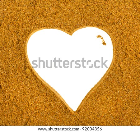 Heart Frame of Curry Powder Mix Surface Background - stock photo