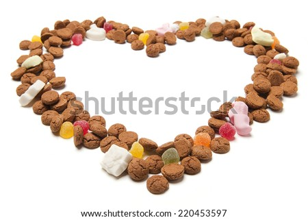 Heart frame of gingerbread nuts or pepernoten, typical Dutch candy for a dutch holiday sinterklaas on the fifth of december - stock photo