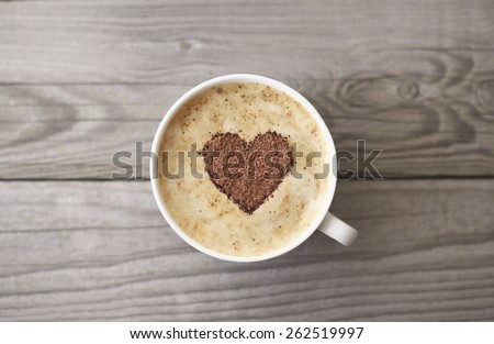Heart from chocolate on coffee. Concept and idea - stock photo