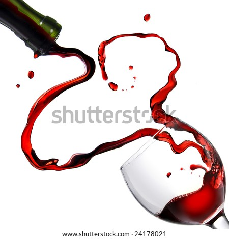 Heart from pouring red wine in goblet isolated on white - stock photo