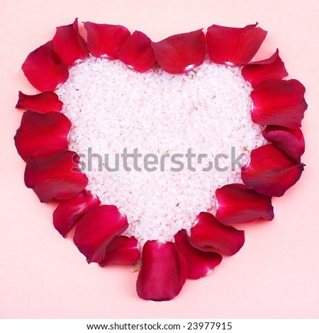 Heart from rose petals and spa salt - stock photo