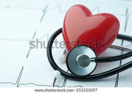 Heart health concept, heart shape with stethoscope and EKG - stock photo