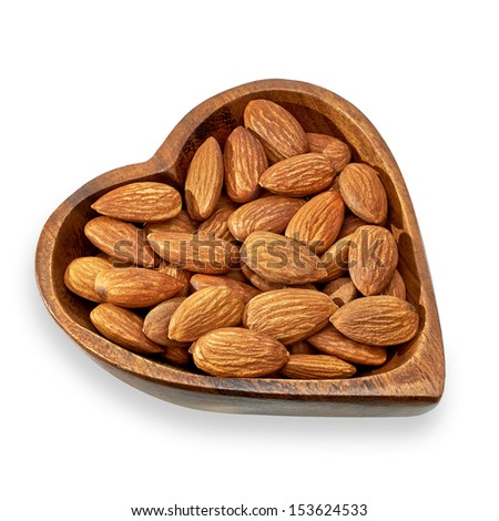 Heart healthy almonds on white background - stock photo