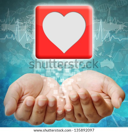 Heart icon on hand ,medical background - stock photo