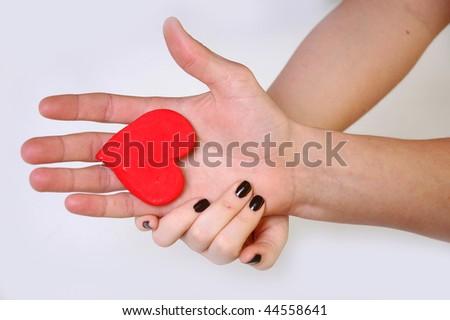 Heart in hands - stock photo