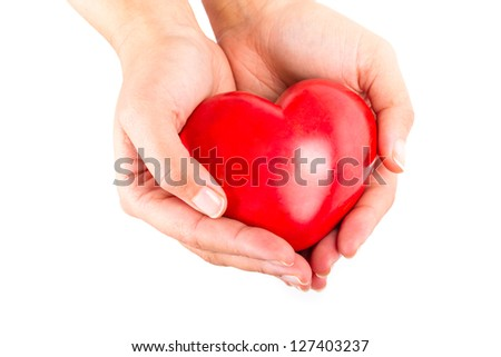 Heart in hands as love and health symbol - stock photo