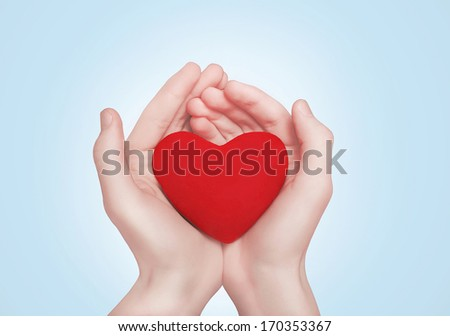 Heart in hands. Valentine's day, romance, love concept  - stock photo