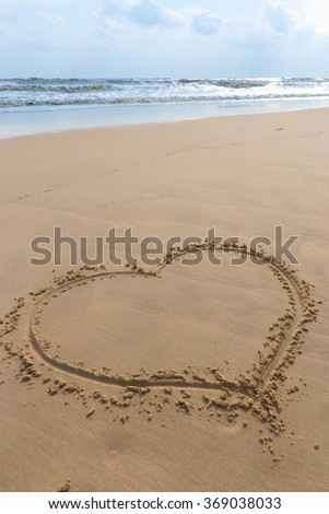 heart in sand at the beach - stock photo