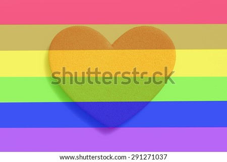 Heart in the gay pride flag. - stock photo