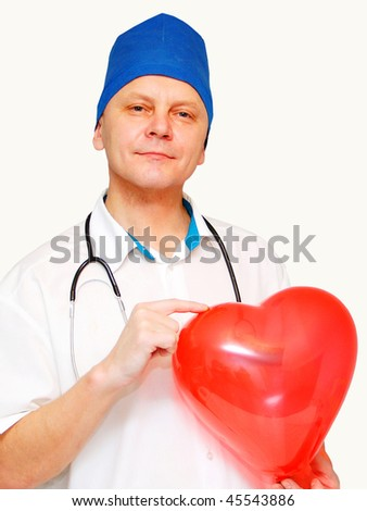 Heart in the hands of a doctor insulated on white.  Love and health care concept. - stock photo