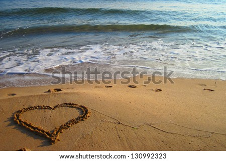 heart in the sand on the beach - stock photo