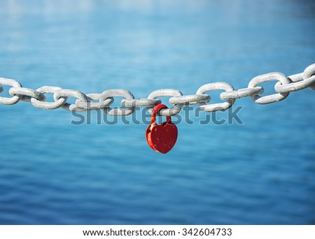 heart lock connected to the chain - stock photo