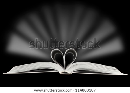 Heart made of book pages with light flashing - stock photo