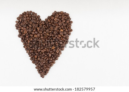 Heart made of coffee beans - stock photo