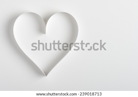 Heart made of paper on white background - stock photo