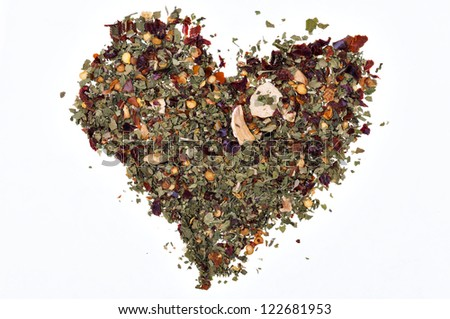 heart made with various spices on white background - stock photo
