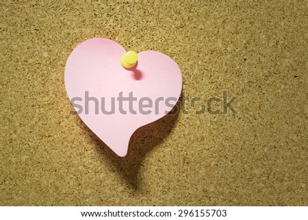 heart note paper taped on cork board background - stock photo