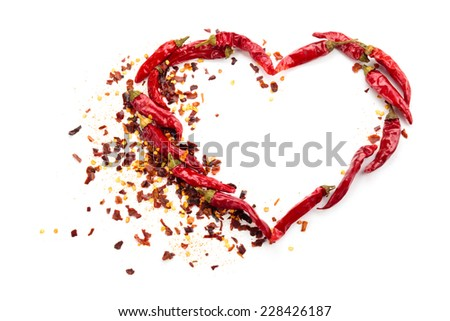 Heart of chili peppers isolated on white background. - stock photo