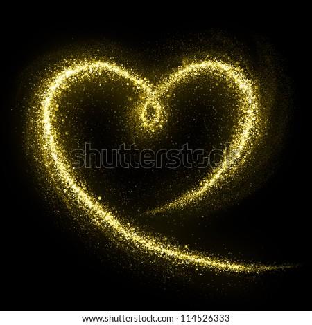 Heart of gold glittering star dust. Love concept. - stock photo
