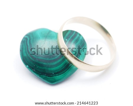 heart of malachite and wedding rings on a white background - stock photo