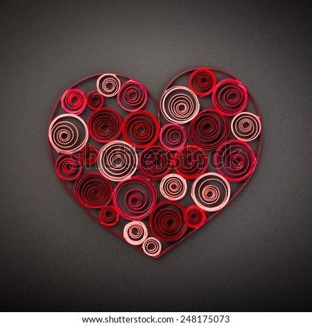 Heart of paper quilling on black background - stock photo