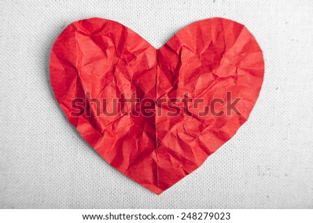 heart of red paper on canvas - stock photo