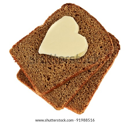 heart of the butter on the bread - stock photo
