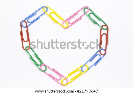 Heart of the colored paper clips on a white background - stock photo