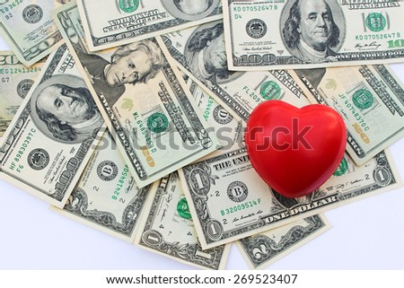 Heart on background of dollars  - stock photo