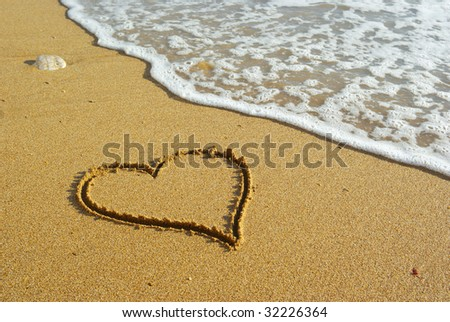 Heart on beach. Romantic composition. - stock photo