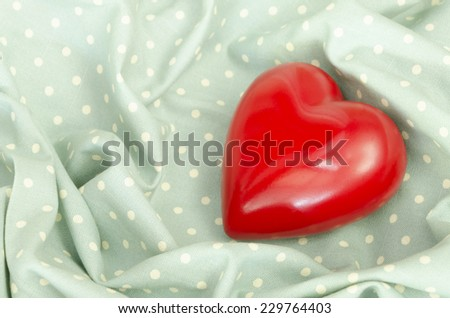 Heart  on the fabric - stock photo