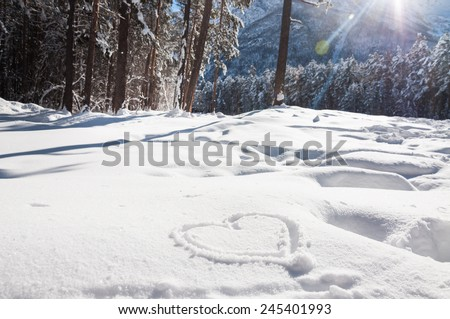 Heart on the snow. Winter landscape in the mountain at sunset - stock photo