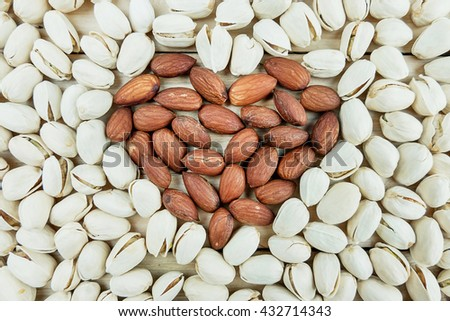Heart or almond and Pistachios nut - stock photo