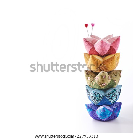 Heart pinheads in heap pincushions isolated on white - stock photo