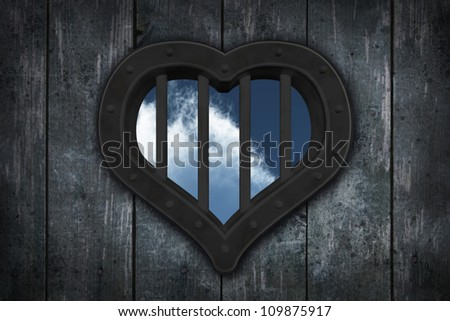 heart prison window on wooden planks background - 3d illustration - stock photo
