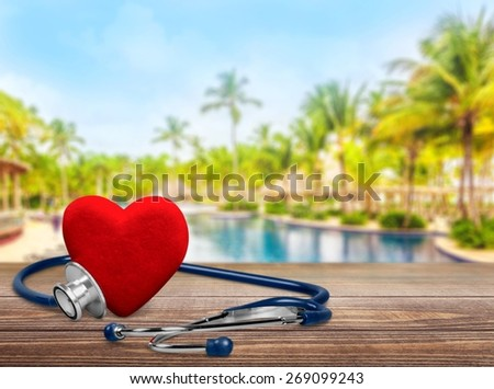 Heart. Red heart and a stethoscope, isolated on white background - stock photo