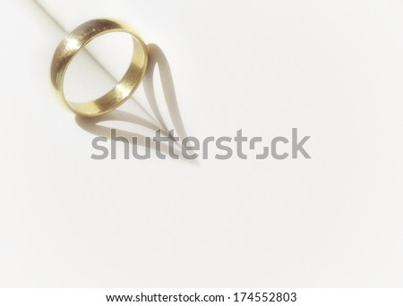 heart shadow with rings on a book middle write your text in white space with grain vintage - stock photo
