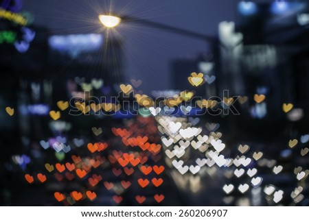 Heart shape bokeh from car light on the traffic road and the lamp - stock photo