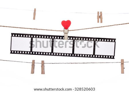 heart  shape clip on a clothesline , hanging Negatives, love movie memory - stock photo