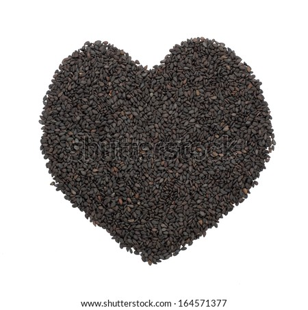 Heart shape from black sesame seed isolated on white - stock photo
