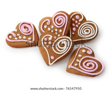 Heart shape ginger breads decorated with pink and white glazing - stock photo
