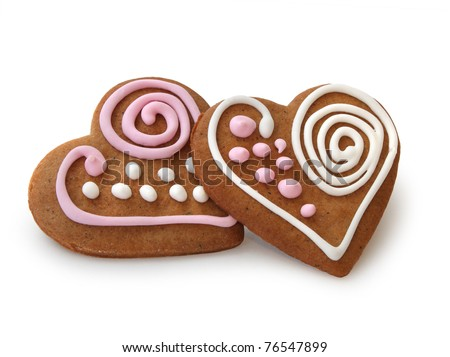 Heart shape ginger breads decorated with pink and white sugar glazing - stock photo