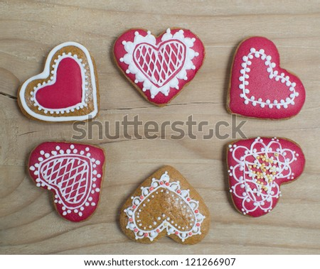 Heart shape gingerbread on wooden background - stock photo