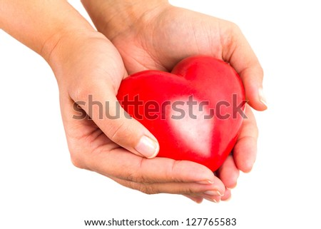 Heart shape in hands as love symbol - stock photo
