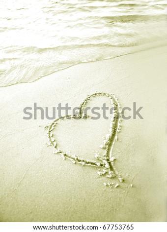 heart shape in sand beach - stock photo