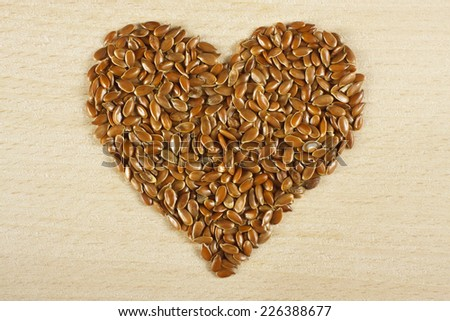 Heart  shape made from flax seeds - stock photo