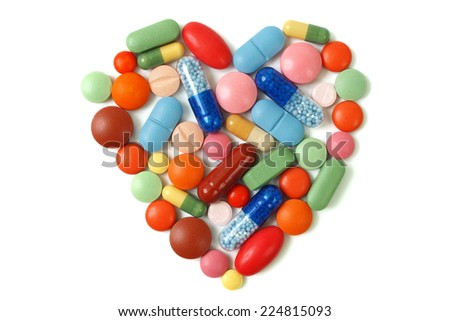 Heart shape made from pills and capsules - stock photo