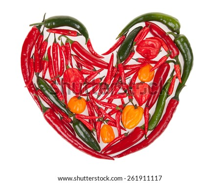 Heart shape made of chilli peppers isolated on white background - stock photo