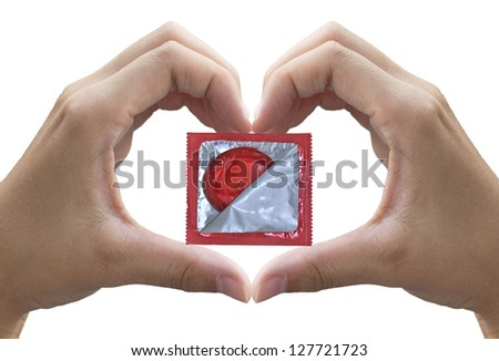 heart shape made of two beautiful palms with condom (with clipping path) - stock photo