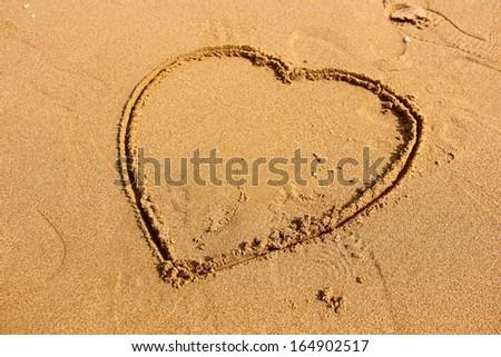 Heart shape on beach. - stock photo